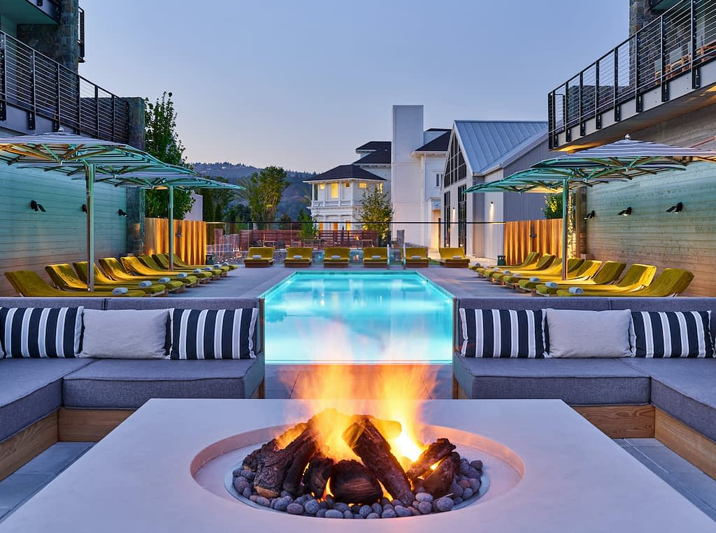 The beautiful exterior pool & firepit at Alila Napa Valley
